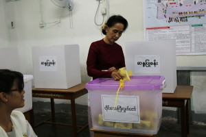 In this photograph taken on November 8, 2015, Myanmar opposition leader Aung San Suu Kyi and head of the National League for Democracy (NLD) party casts her ballot at a polling center in Yangon. Myanmar's powerful army chief has congratulated Aung San Suu Kyi's opposition party for winning a majority in the country's historic general election, in a statement released late November 11, 2015 on the military's official Facebook page. AFP PHOTO / STR / AFP / -