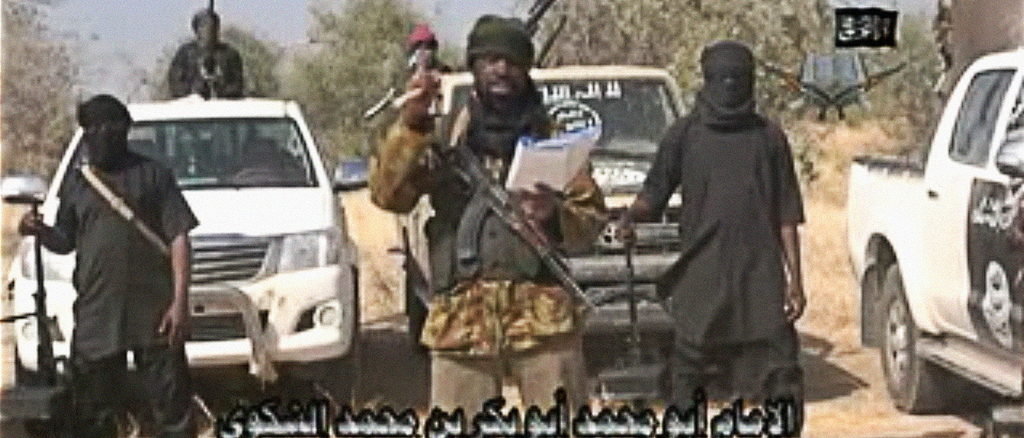 "A screen grab made on January 20, 2015 from a video of Nigerian Islamist extremist group Boko Haram obtained by AFP shows the leader of the Islamist extremist group Boko Haram Abubakar Shekau delivering a message. Boko Haram has claimed a massive attack feared to be the worst in its six-year insurgency and threatened Nigeria's neighbours, as talks began for a regional response to the militants and fears grew of further violence. ""We killed the people of Baga. We indeed killed them, as our Lord instructed us in His Book,"" Shekau said in the 35-minute message, which was posted on YouTube. AFP PHOTO / BOKO HARAM  -- RESTRICTED TO EDITORIAL USE - MANDATORY CREDIT ""AFP PHOTO / BOKO HARAM"" - NO MARKETING NO ADVERTISING CAMPAIGNS - DISTRIBUTED AS A SERVICE TO CLIENTS -- / AFP PHOTO / BOKO HARAM / -"