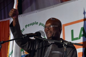 Roch Marc Christian Kabore waves to supporters at party headquarter in Ouagadougou on December 1, 2015 after winning Burkina Faso's presidential election, official results showed, after a year of turmoil that saw the west African country's former leader deposed and the military try to seize power in a coup. AFP PHOTO / ISSOUF SANOGO / AFP / ISSOUF SANOGO