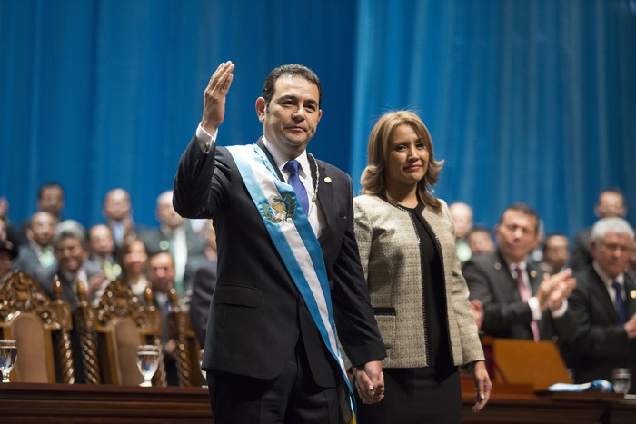 Guatemalan new President Jimmy Morales (L) waves next to his wife Hilda Marroquin during his inauguration ceremony in Guatemala City, on January 14, 2016. Morales, a former TV comic elected Guatemala's new president on a wave of public revulsion against widespread graft, took office in a ceremony attended by leaders from the Americas. AFP PHOTO / Luis ECHEVERRIA / AFP / LUIS ECHEVERRIA